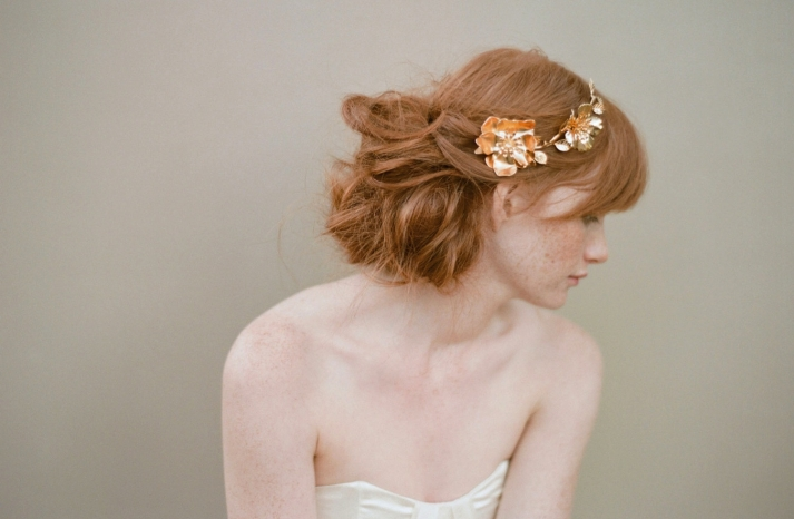 Tousled wedding updo with gold crown