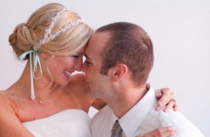 Swept back wedding updo with beaded headband