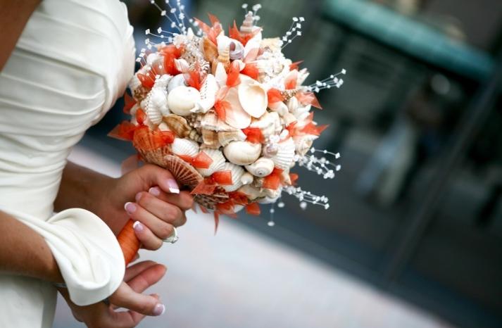 Orange and ivory seashell wedding bouquet