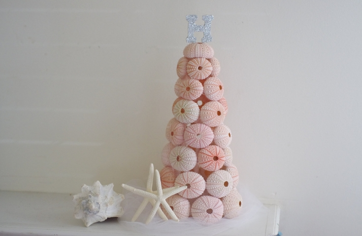 faux wedding cake of pink sea urchins