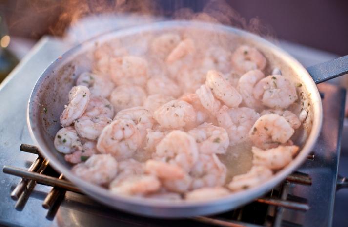 Simmering shrimp at wedding reception