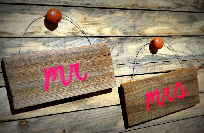Rustic wood with neon Mr and Mrs wedding signs