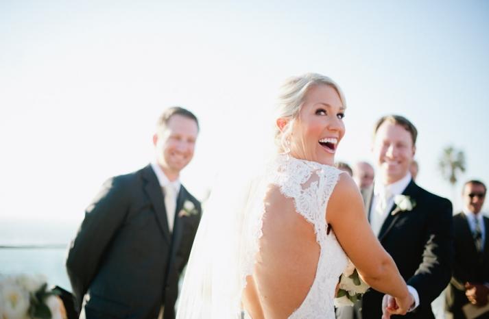 Beach bride wears lace mermaid wedding dress with open back