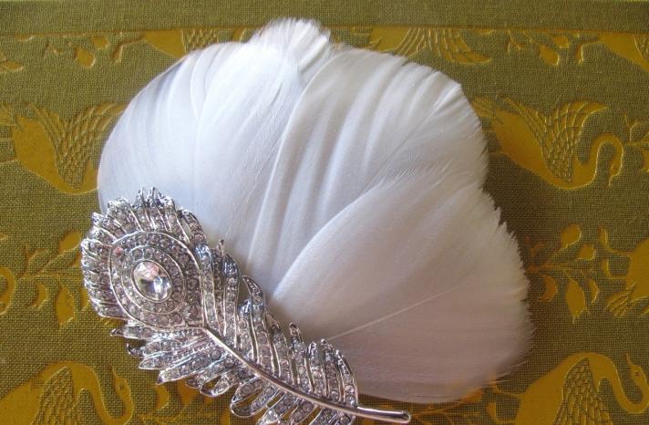 White peacock feather wedding fascinator