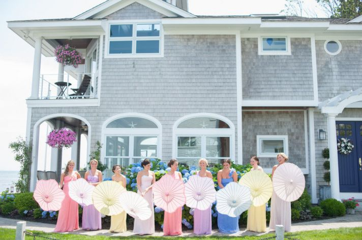 mix and match pastel bridesmaids with parasols