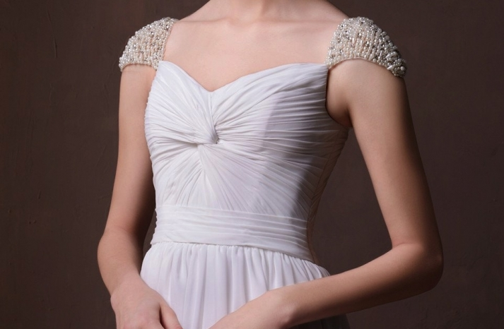 Pearl and crystal beaded cap sleeves on chiffon wedding dress