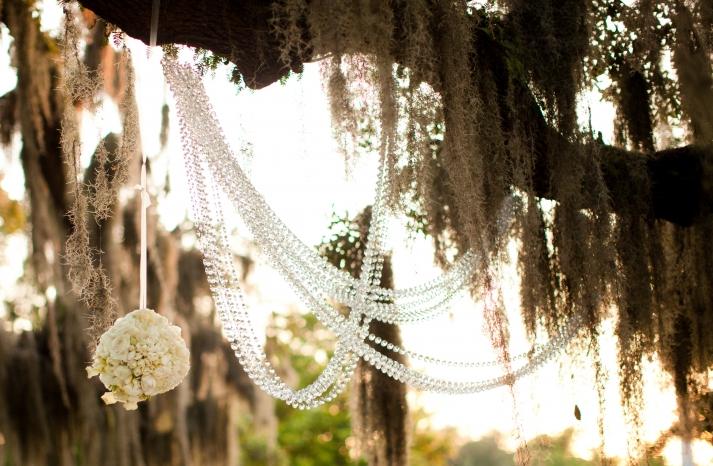 Outdoor wedding reception decor draped crystals