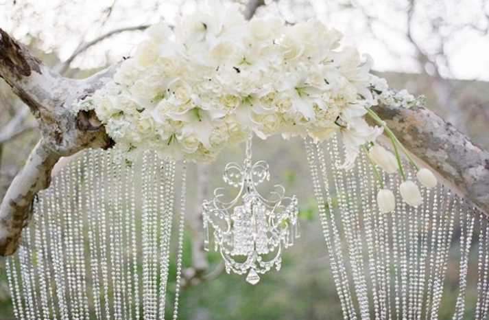 glamping wedding style floral crystal adorned arbor