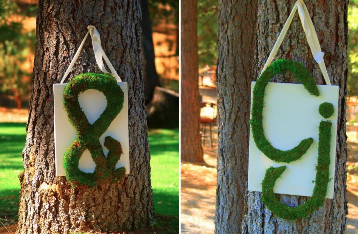Rustic glamping wedding inspiration moss initials hung on trees