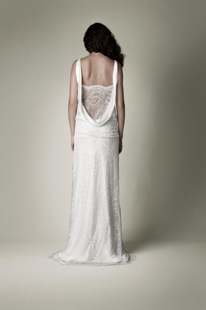 white vintage wedding dress with lace statement back