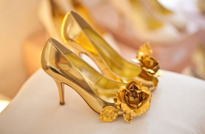 gold slick wedding shoes with rosette accents
