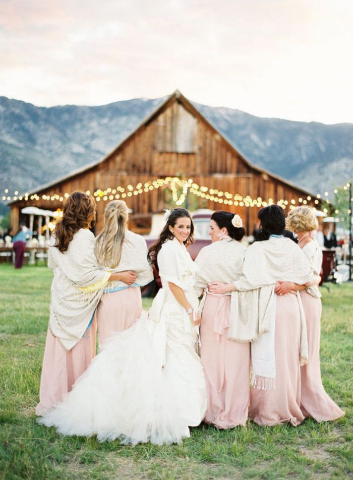 Vera Wang Bride poses with bridesmaids in pale pink
