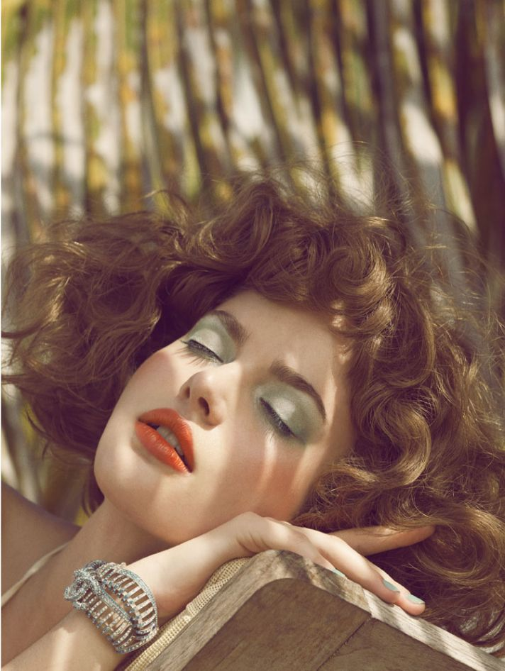 Red lips and sky blue eye lids for retro glam brides