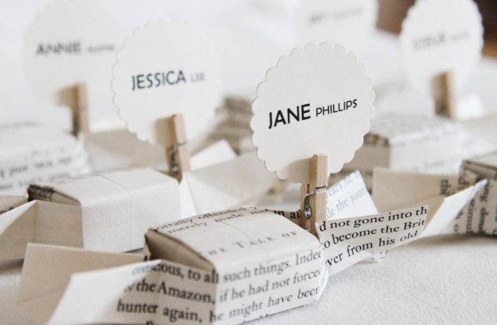 Origami candy boxes hold wedding guest escort cards and favors
