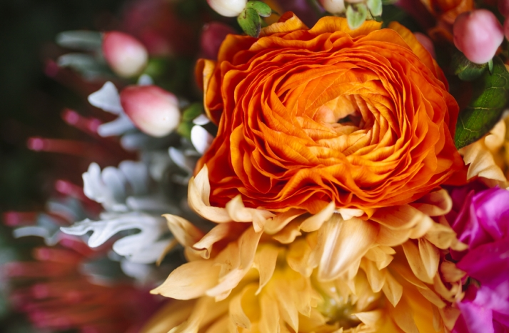 Bright summer wedding orange ranunculus in the bridal bouquet