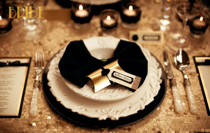 sparkly gold wedding table linens with black accents