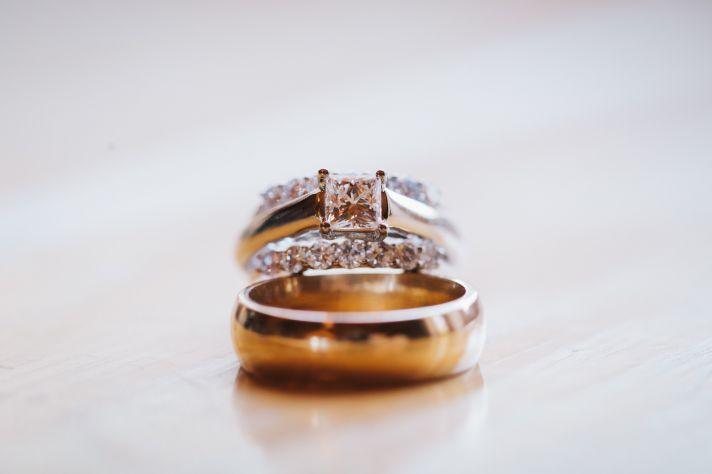 Engagement ring and wedding bands photo by Lisa Mallory Photography