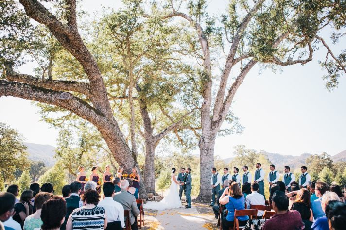bride and groom at their outdoor ceremony altar