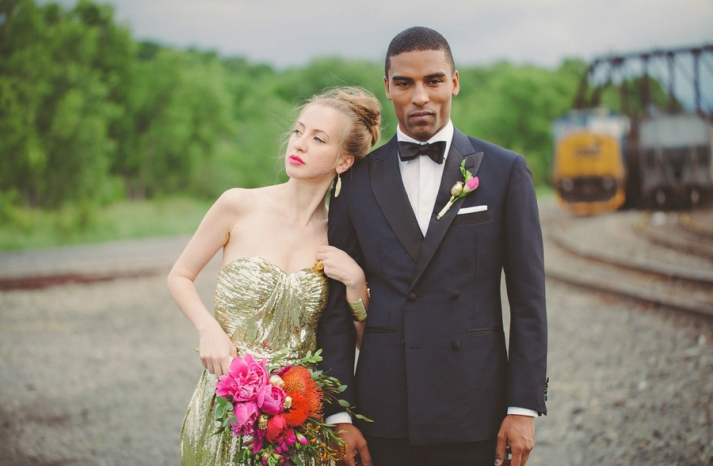 groom wears deep navy tux with black lapel and bow tie