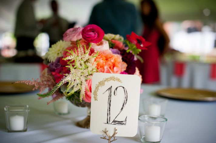 Table number and simple bright centerpiece