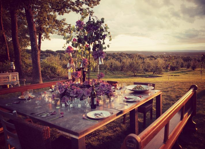 Outdoor square reception table with purple centerpiece