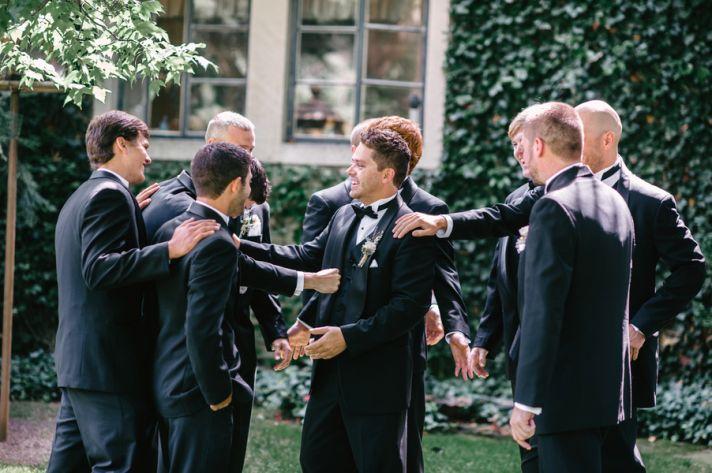 Groomsmen congratulate groom