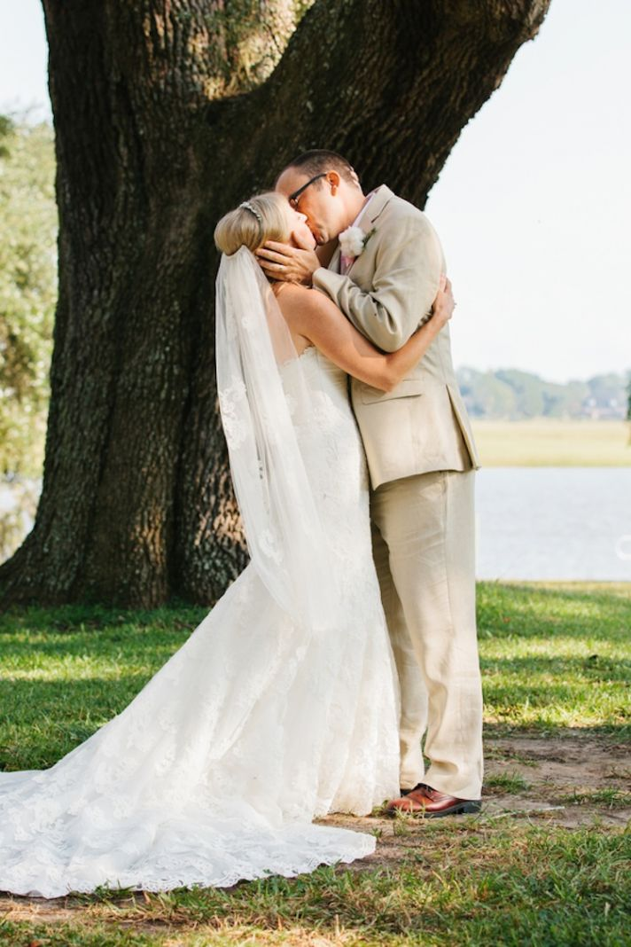 Outdoor ceremony kiss