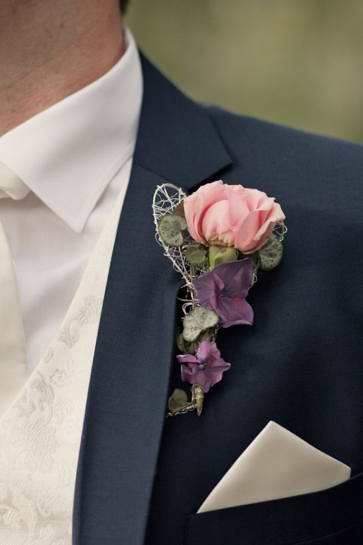 Groom boutonniere with a pink rose