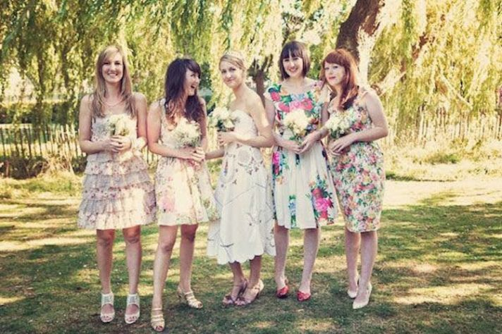 Mix and matched floral bridesmaids dresses