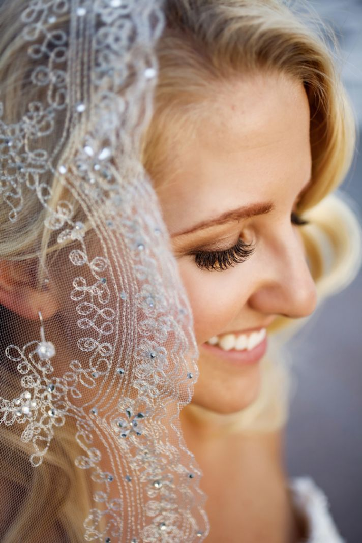Bride close up with bling veil