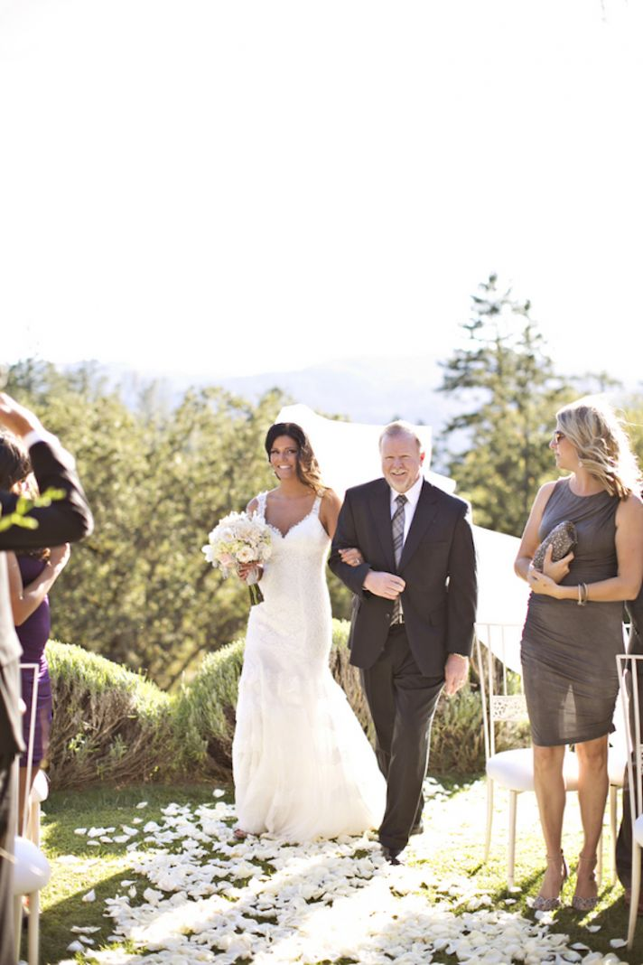 Brunette bride with father at an outdoor ceremony