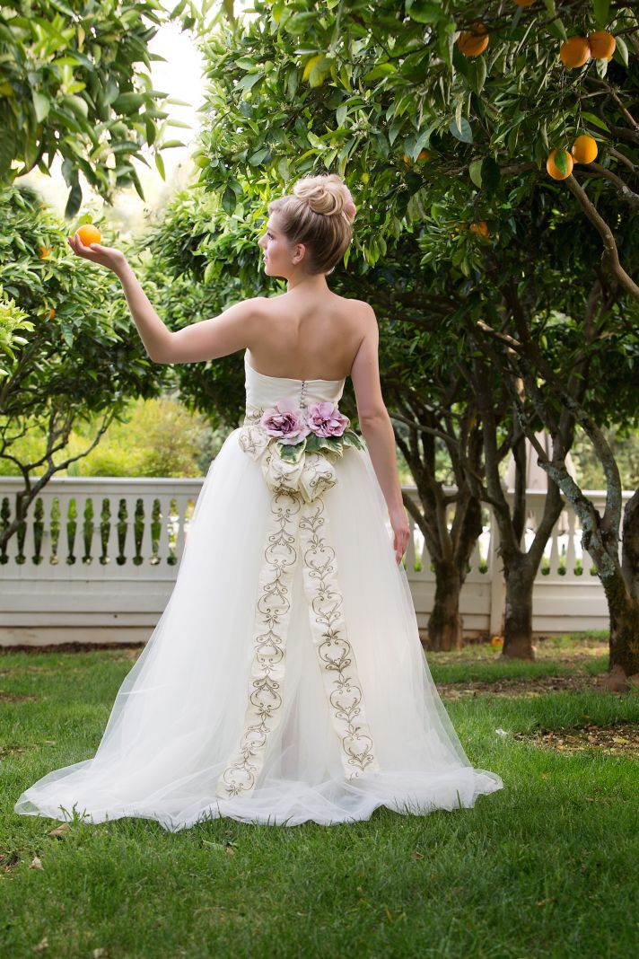 Unique floral bow wedding gown by Amy Jo Tatum