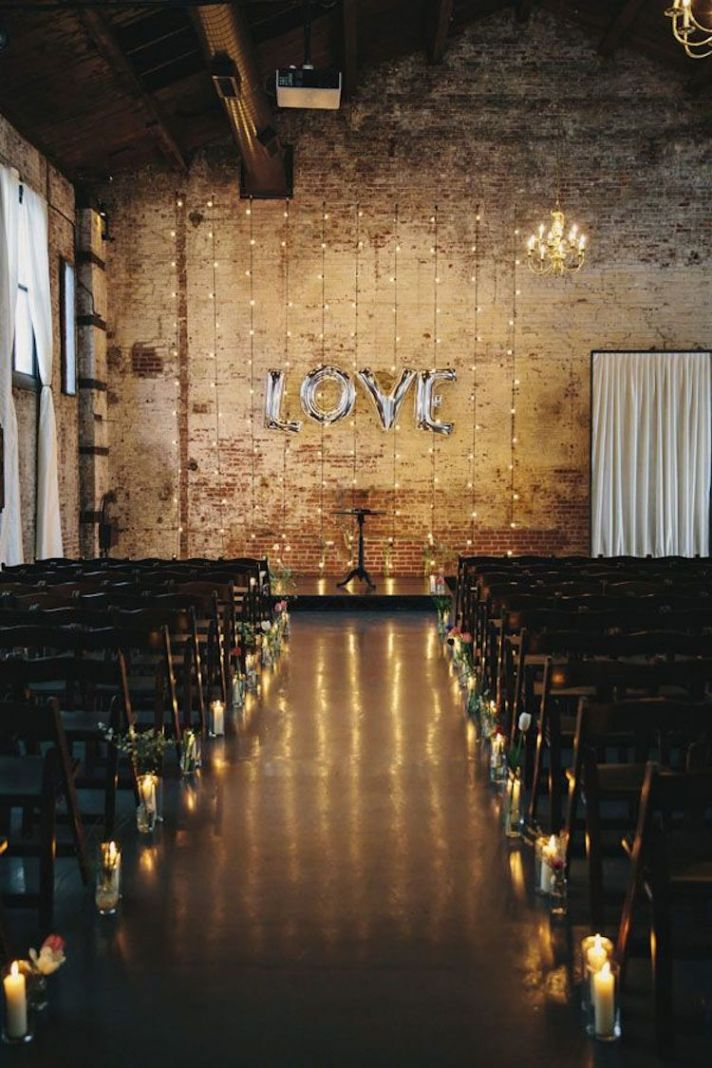 Ceremony Aisle with Love Sign At Alter