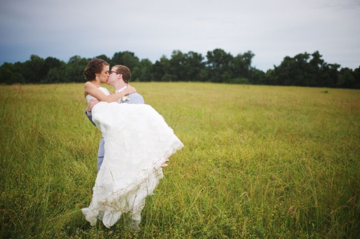 Sweet Couple in A Field Under Storm Clouds